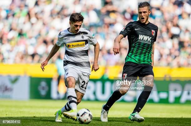 Jonas Hofmann of Borussia Moenchengladbach and Philipp Max of FC Augsburg during the Bundesliga Match between Borussia Moenchengladbach and FC...