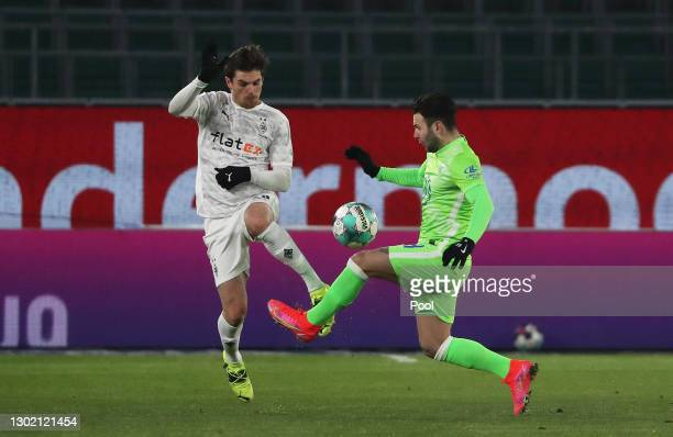 Jonas Hofmann of Borussia Moenchengladbach and Renato Steffen of VfL Wolfsburg battle for the ball during the Bundesliga match between VfL Wolfsburg...