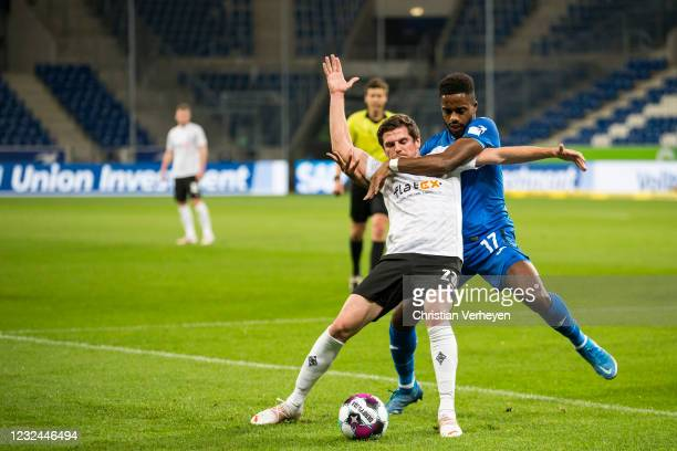 Jonas Hofmann of Borussia Moenchengladbach and Ryan Sessegnon of Hoffenheim battle for the ball during the Bundesliga match between TSG 1899...