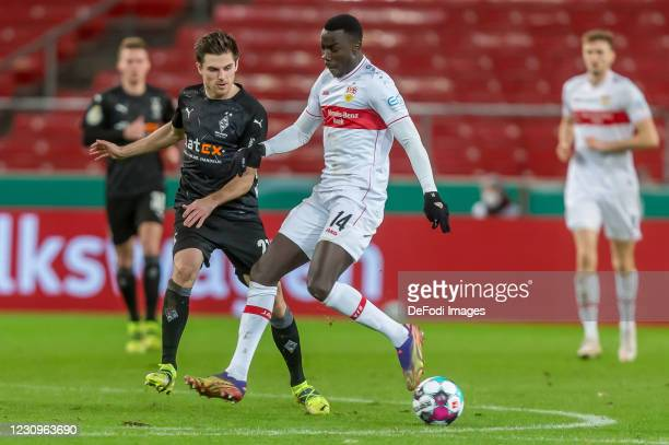 Jonas Hofmann of Borussia Moenchengladbach and Silas Wamangituka of VfB Stuttgart battle for the ball during the DFB Cup Round of Sixteen match...