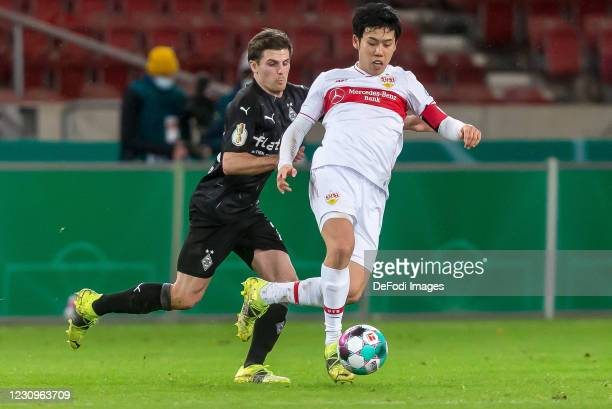 Jonas Hofmann of Borussia Moenchengladbach and Wataru Endo of VfB Stuttgart battle for the ball during the DFB Cup Round of Sixteen match between VfB...