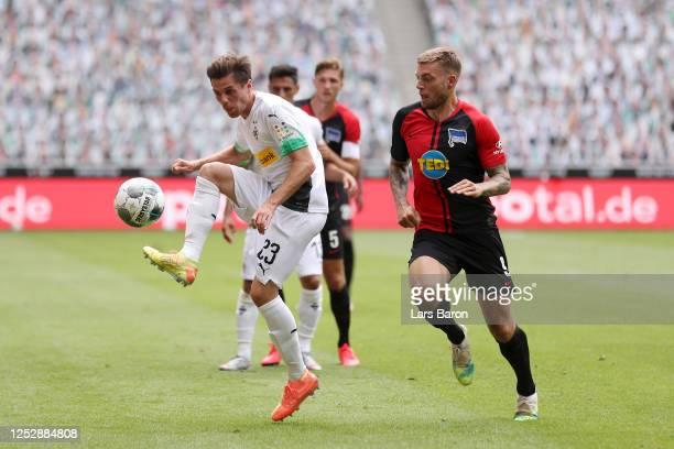 Jonas Hofmann of Borussia Moenchengladbach battles for possession with Alexander Esswein of Hertha BSC during the Bundesliga match between Borussia...