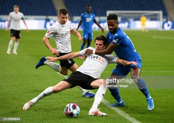 Jonas Hofmann of Borussia Moenchengladbach battles for possession with Ryan Sessegnon of TSG 1899 Hoffenheim during the Bundesliga match between TSG...