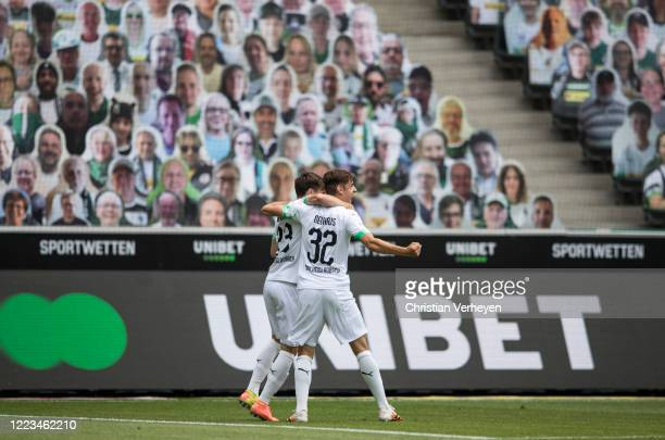 Jonas Hofmann of Borussia Moenchengladbach celebrate with team mate Florian Neuhaus after he score his teams first goal during the Bundesliga match...