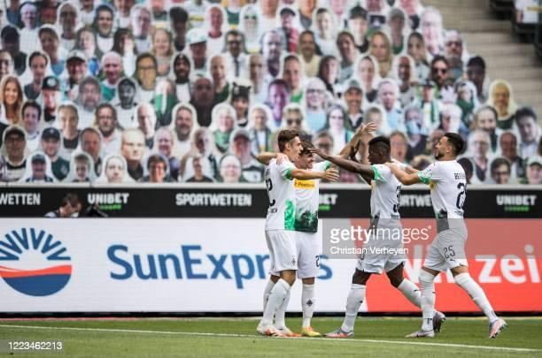 Jonas Hofmann of Borussia Moenchengladbach celebrate with team mates after he score his teams first goal during the Bundesliga match between Borussia...
