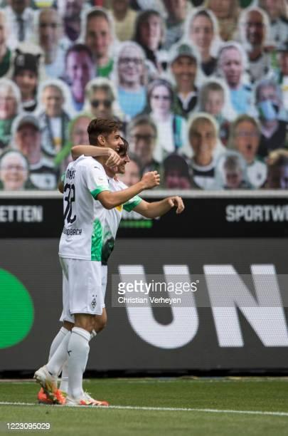 Jonas Hofmann of Borussia Moenchengladbach celebrate with teammate Florian Neuhaus after scoring his team's first goal during the Bundesliga match...
