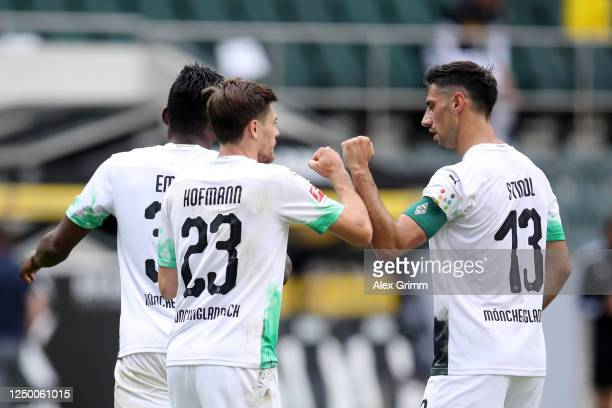 Jonas Hofmann of Borussia Moenchengladbach celebrates after scoring his team's first goal with teammate Lars Stindl during the Bundesliga match...