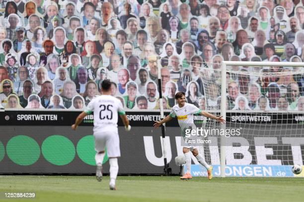 Jonas Hofmann of Borussia Moenchengladbach celebrates after scoring his team's first goal during the Bundesliga match between Borussia...