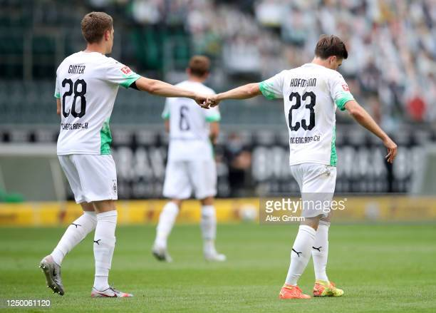Jonas Hofmann of Borussia Moenchengladbach celebrates with teammate Matthias Ginter after scoring his team's first goal during the Bundesliga match...