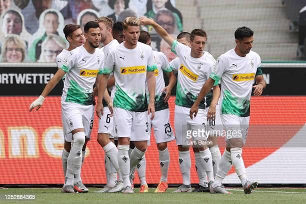 Jonas Hofmann of Borussia Moenchengladbach celebrates with teammates after scoring his team's first goal during the Bundesliga match between Borussia...
