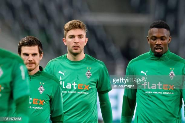 Jonas Hofmann of Borussia Moenchengladbach, Christoph Kramer of Borussia Moenchengladbach and Marcus Thuram of Borussia Moenchengladbach look on...