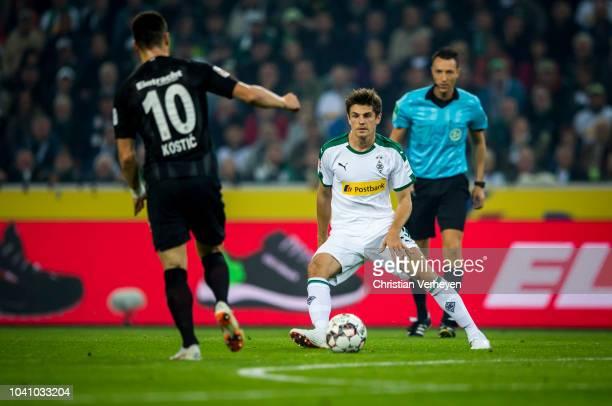Jonas Hofmann of Borussia Moenchengladbach controls the ball during the Bundesliga match between Borussia Moenchengladbach and Eintracht Frankfurt at...