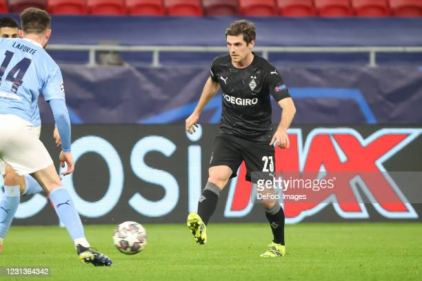 Jonas Hofmann of Borussia Moenchengladbach controls the ball during the UEFA Champions League Round of 16 match between Borussia Moenchengladbach and...
