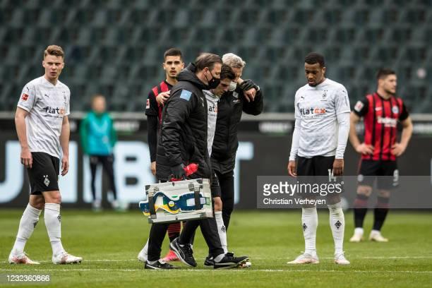 Jonas Hofmann of Borussia Moenchengladbach gets treated during the Bundesliga match between Borussia Moenchengladbach and Eintracht Frankfurt at...