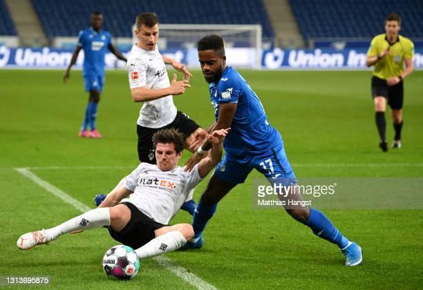 Jonas Hofmann of Borussia Moenchengladbach is challenged by Ryan Sessegnon of TSG 1899 Hoffenheim during the Bundesliga match between TSG Hoffenheim...