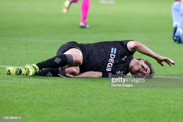 Jonas Hofmann of Borussia Moenchengladbach is injury during the UEFA Champions League Round of 16 match between Borussia Moenchengladbach and...