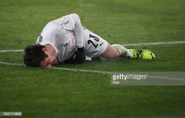 Jonas Hofmann of Borussia Moenchengladbach reacts as he lays on the pitch during the Bundesliga match between VfL Wolfsburg and Borussia...