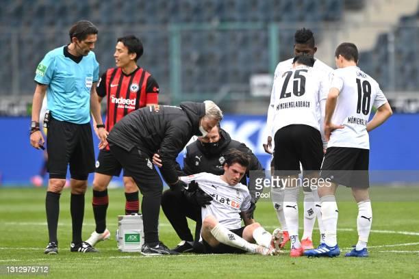 Jonas Hofmann of Borussia Moenchengladbach receives medical treatment during the Bundesliga match between Borussia Moenchengladbach and Eintracht...