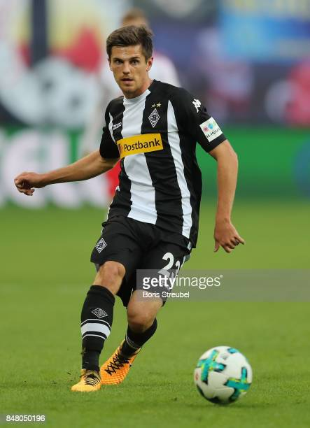 Jonas Hofmann of Borussia Moenchengladbach runs with the ball during the Bundesliga match between RB Leipzig and Borussia Moenchengladbach at Red...