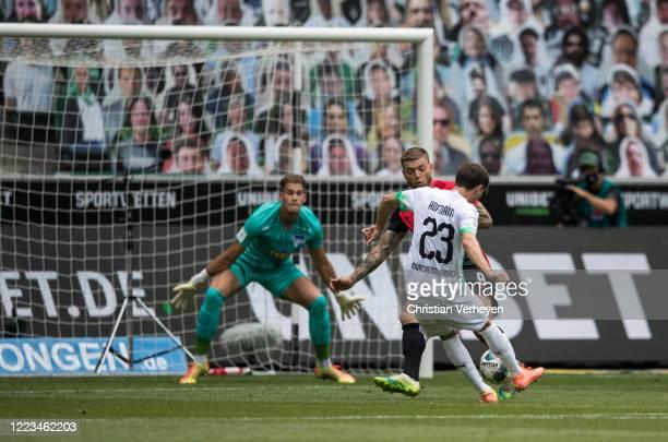 MOENCHENGLADBACH GERMANY JUNE Jonas Hofmann of Borussia Moenchengladbach score his teams first goal during the Bundesliga match between Borussia...