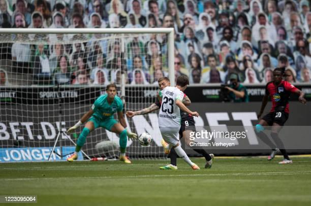 Jonas Hofmann of Borussia Moenchengladbach scores his team's first goal during the Bundesliga match between Borussia Moenchengladbach and Hertha BSC...