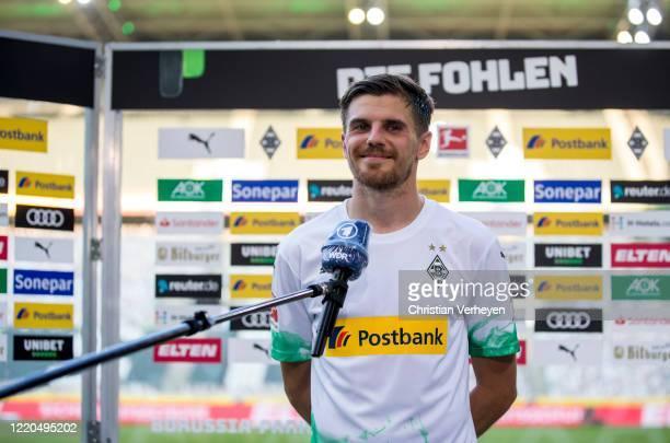 Jonas Hofmann of Borussia Moenchengladbach talks to the media after the Bundesliga match between Borussia Moenchengladbach and VfL Wolfsburg at...