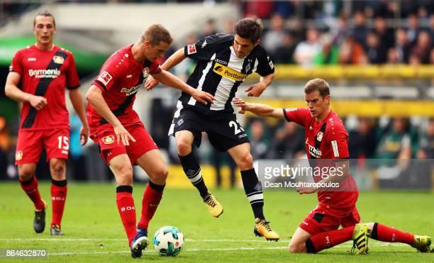 Jonas Hofmann of Borussia Monchengladbach battles for the ball with Sven Bender and Lars Bender of Bayer 04 Leverkusen during the Bundesliga match...
