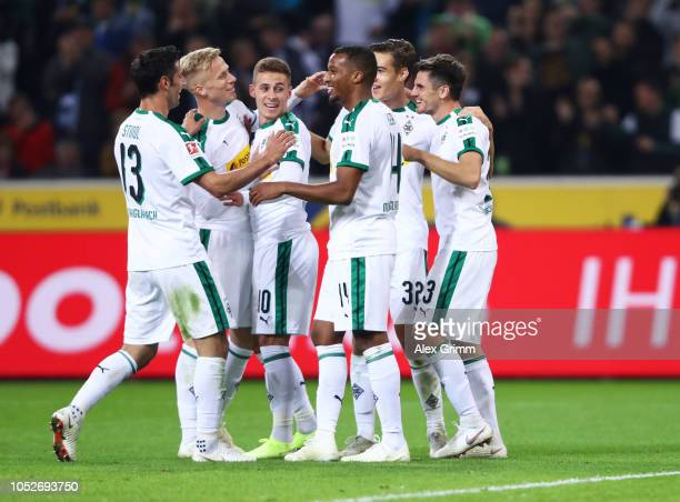 Jonas Hofmann of Borussia Monchengladbach celebrates after scoring his team's fourth goal and completing his hat trick with team mates during the...