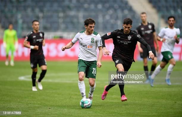 Jonas Hofmann of Borussia Monchengladbach runs with the ball whilst under pressure from Atakan Karazor of VfB Stuttgart during the Bundesliga match...
