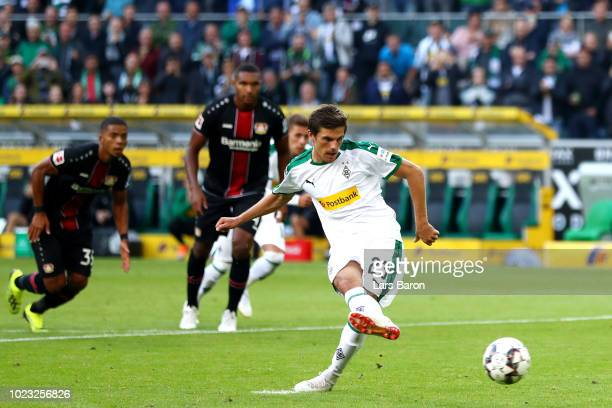 Jonas Hofmann of Borussia Monchengladbach scores his sides first goal from the penalty spot during the Bundesliga match between Borussia...