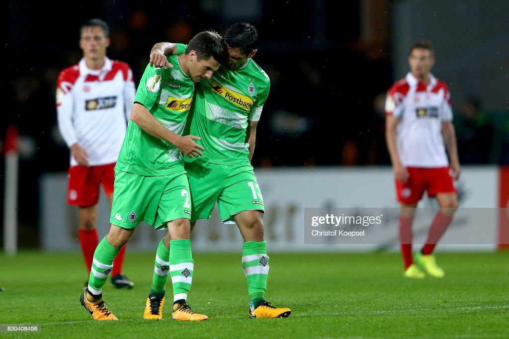 Jonas Hofmann of Mnchengladbach celebrates the first goal with Lars Stindl of Mnchengladbach during the DFB Cup first round match between Rot-Weiss Essen and Borussia Moenchengladbach at Stadion Essen on August 11, 2017 in Essen, Germany.