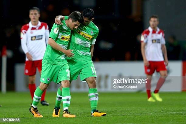 Jonas Hofmann of Mnchengladbach celebrates the first goal with Lars Stindl of Mnchengladbach during the DFB Cup first round match between RotWeiss...
