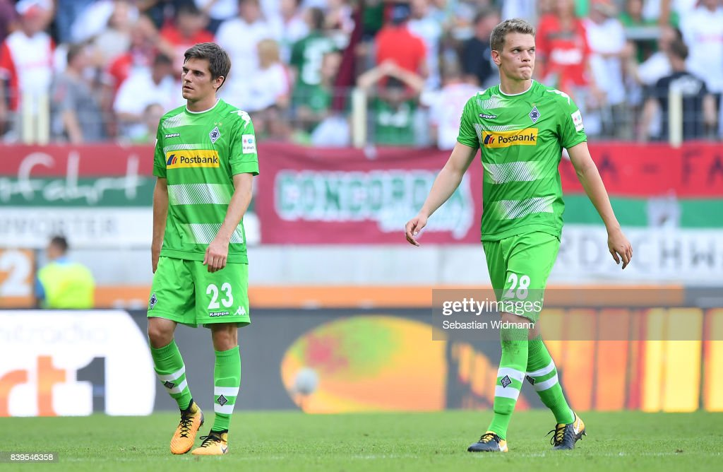 Jonas Hofmann of Moenchengladbach (l) and Matthias Ginter of Moenchengladbach dejected after the Bundesliga match between FC Augsburg and Borussia Moenchengladbach at WWK-Arena on August 26, 2017 in Augsburg, Germany.