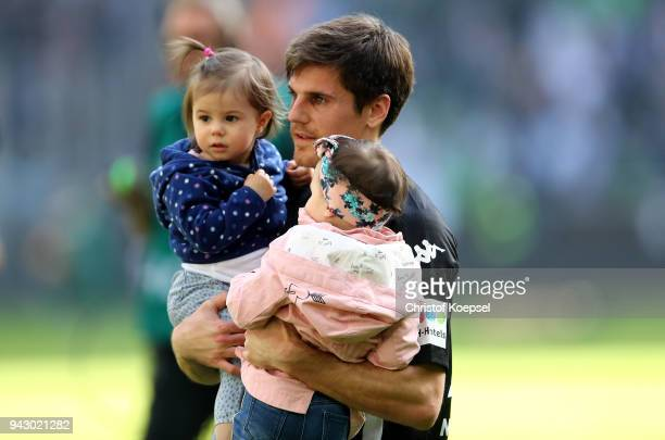 Jonas Hofmann of Moenchengladbach celebrates the 21 victory with his children during the Bundesliga match between Borussia Moenchengladbach and...