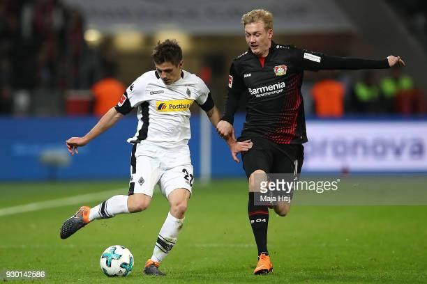 Jonas Hofmann of Moenchengladbach fights for the ball with Julian Brandt of Bayer Leverkusen during the Bundesliga match between Bayer 04 Leverkusen...