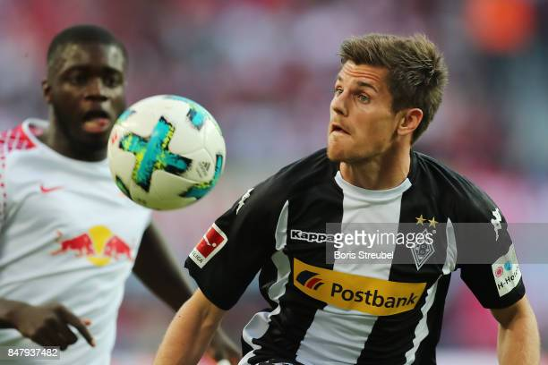 Jonas Hofmann of Moenchengladbach handles the ball during the Bundesliga match between RB Leipzig and Borussia Moenchengladbach at Red Bull Arena on...