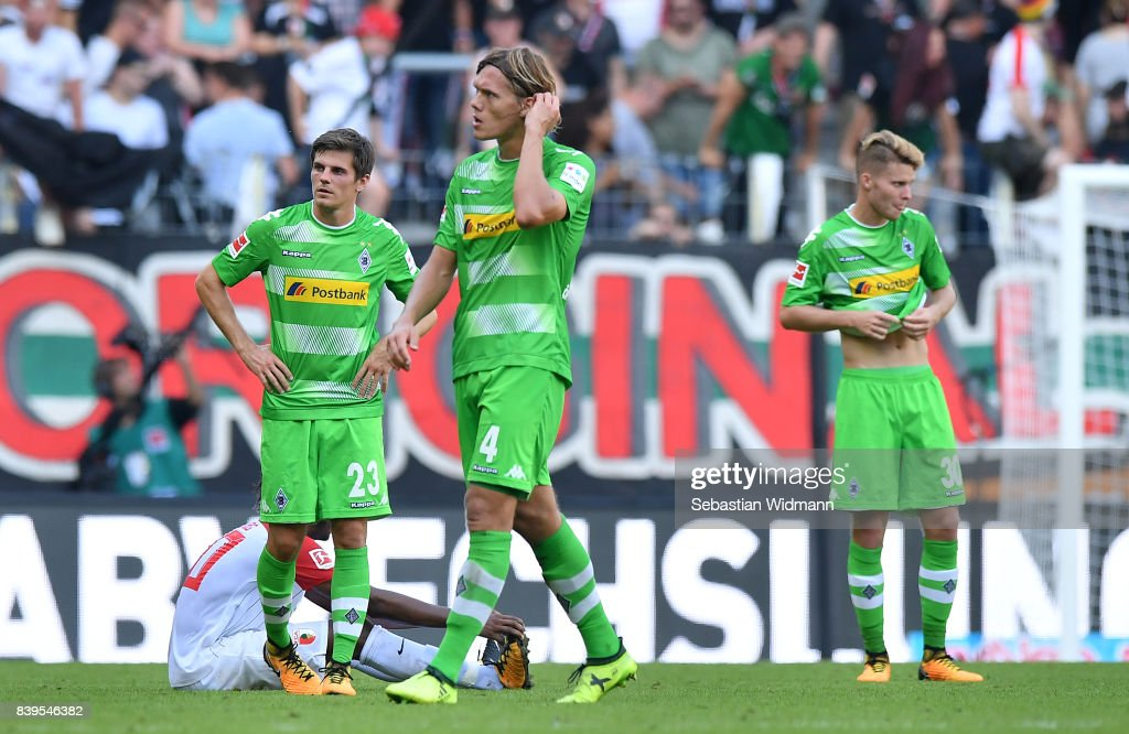 Jonas Hofmann of Moenchengladbach (l), Jannik Vestergaard of Moenchengladbach (c) and Nico Elvedi of Moenchengladbach dejected after the Bundesliga match between FC Augsburg and Borussia Moenchengladbach at WWK-Arena on August 26, 2017 in Augsburg, Germany.