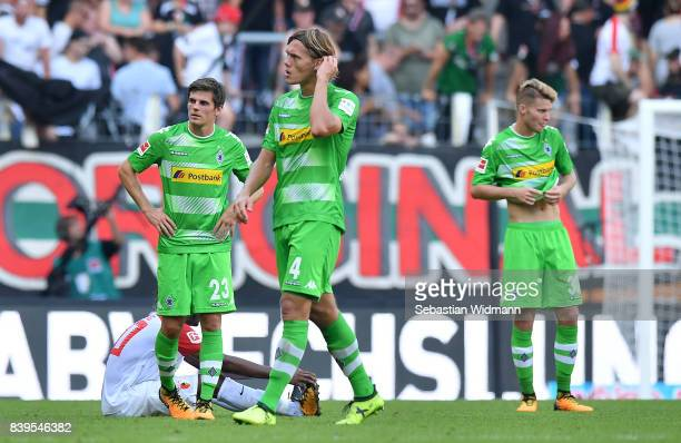 Jonas Hofmann of Moenchengladbach Jannik Vestergaard of Moenchengladbach and Nico Elvedi of Moenchengladbach dejected after the Bundesliga match...