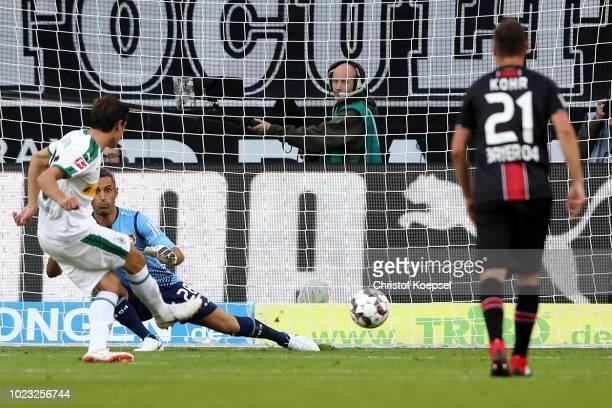 Jonas Hofmann of Moenchengladbach scores the first goal by penalty against Ramazan Oezcan of Leverkusen during the Bundesliga match between Borussia...