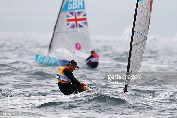 Jonas HoghChristensen of Denmark and Ben Ainslie of Great Britain compete in the Men's Finn Sailing on Day 4 of the London 2012 Olympic Games at...