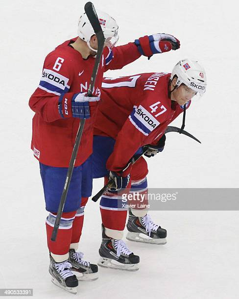 Jonas Holos and alexander Bonsaksen of Norway are disapointed after defeact during the 2014 IIHF World Championship between Slovakia and Norway at...