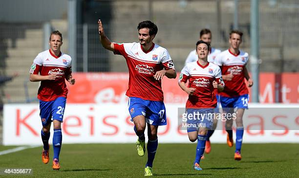 Jonas Hummels of Unterhaching celebrates with team-mates after scoring his team's second goal during the Third League match between SpVgg...