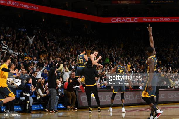 Jonas Jerebko celebrates with Stephen Curry 30 of the Golden State Warriors celebrates after hitting a midcourt buzzerbeater shot at the end of the...