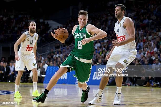 Jonas Jerebko of Boston Celtics drives against Felipe Reyes of Real Madrid during the friendlies of the NBA Global Games 2015 basketball match...