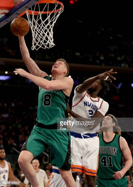 Jonas Jerebko of the Boston Celtics heads for the net as Maurice Ndour of the New York Knicks defends at Madison Square Garden on April 2 2017 in New...