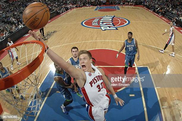 Jonas Jerebko of the Detroit Pistons goes up for a shot attempt past Nathan Jawai of the Minnesota Timberwolves in a game at the Palace of Auburn...
