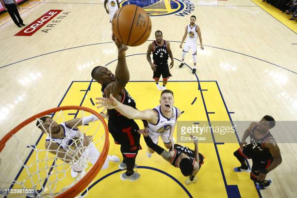 Jonas Jerebko of the Golden State Warriors attempts a shot against Serge Ibaka of the Toronto Raptors in the second half during Game Three of the...