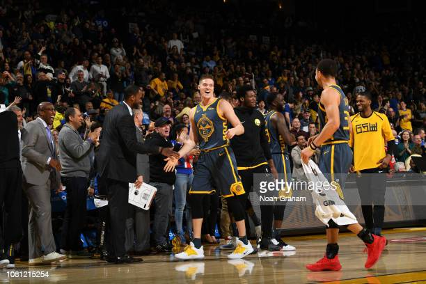 Jonas Jerebko of the Golden State Warriors celebrates after hitting a midcourt buzzerbeater shot at the end of the first quarter on January 11 2019...