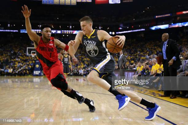 Jonas Jerebko of the Golden State Warriors drives with the ball against Evan Turner of the Portland Trail Blazers in game two of the NBA Western...