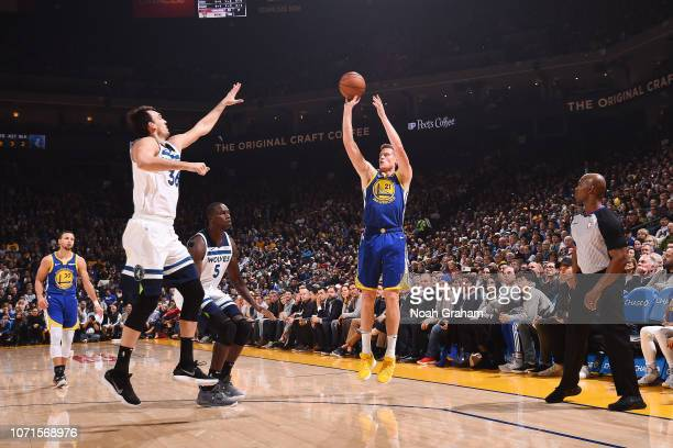Jonas Jerebko of the Golden State Warriors shoots the ball against the Minnesota Timberwolves on December 10 2018 at ORACLE Arena in Oakland...